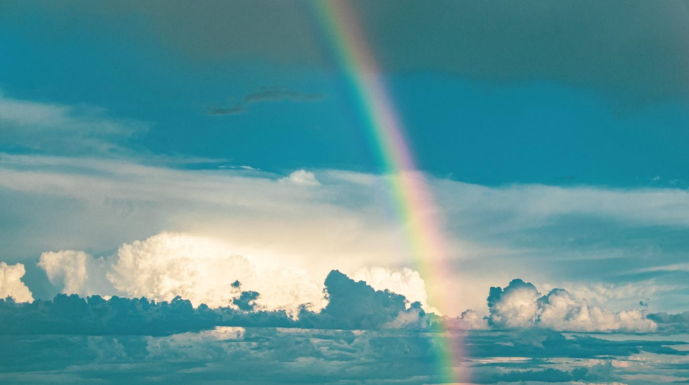 Rainbow in the sky over clouds.